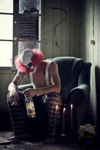 clown with drink and smoke